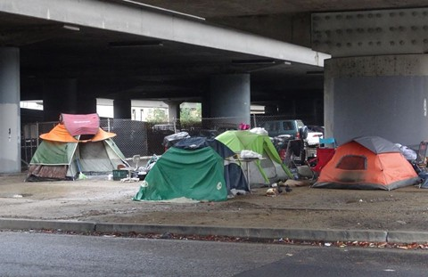 Homeless camp on Webster Street in Oakland. - DARWIN BONDGRAHAM