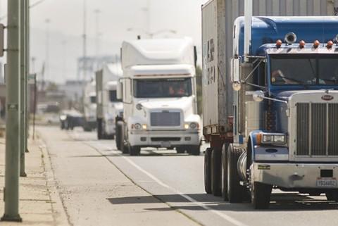 Trucks at the Port of Oakland. - CHRIS DUFFEY