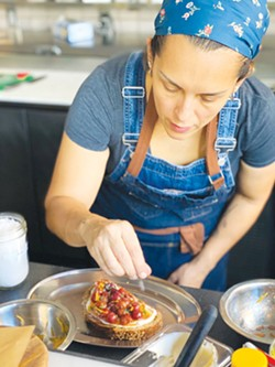 WELL PLACED: Theully Calderwood works on a savory creation. - PHOTO BY DANA SAYEGH HIGHTOWER