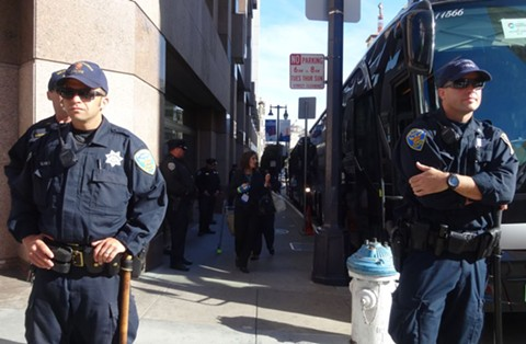 Oakland Mayor Libby Schaaf boards a bus during a police accountability protest at the US Conference of Mayors. - DARWIN BONDGRAHAM