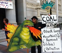 Protesters rallied against coal outside Oakland City Hall on Tuesday. - JEAN TEPPERMAN