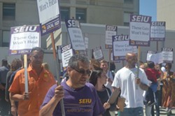 SEIU 1021 members rallied at Highland Hospital against closure of a drug treatment center today. - NGUYEN WEEKS