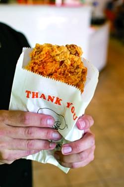 Fried chicken in a bag at Chick & Tea. - BERT JOHNSON