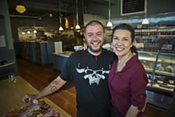 Owners John Blevins (left) and Analiesa Gosnell. - CLOVE AND HOOF