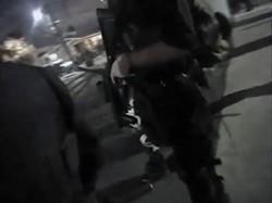 A Hayward police officer holding a 40mm gun.