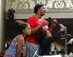Latifa Lewis of Causa Justa :: Just Cause told the council that she and her children are facing displacement from their home. - DARWIN BONDGRAHAM