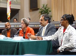 A panel of experts addressed the Oakland city council at Wednesday's hearing on the housing crisis. - DARWIN BONDGRAHAM