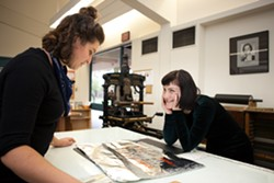 Grace Forrest (L) reviews a book art design. - BERT JOHNSON