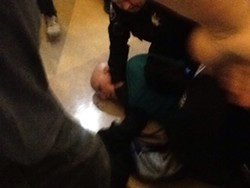 The Alameda renter who was pinned to the floor by police appeared to be in his sixties. - STEVEN TAVARES
