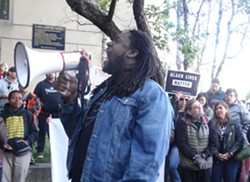 Black Friday 14 supporters, labor unions, workers and others rallied outside of District Attorney Nancy O'Malley's office today. - DARWIN BONDGRAHAM
