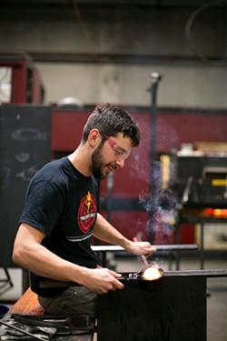Sam Schumacher teaches glass blowing at the Crucible. - BERT JOHNSON
