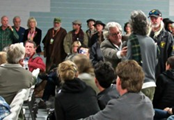 The Emerald Cup organizer and industry icon Tim Blake, far left, talks back to heckler Kevin Saunders during a legalization debate Saturday. - DAVID DOWNS
