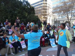 Activists rally for affordable housing impact fees at Oakland City Hall last year. - DARWIN BONDGRAHAM