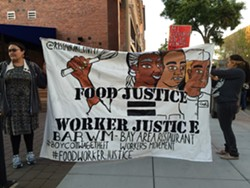 """BARWM supporters carry banner declaring """"Food Justice = Worker Justice"""" - JENNY HUANG/ BARWM"""