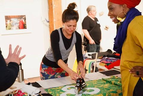 Cristina Victor leading a flag-making workshop at SOMArts Cultural Center. - COURTESY OF CRISTINA VICTOR
