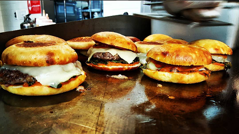 """""""Burgs"""" on the griddle. Via Instagram."""