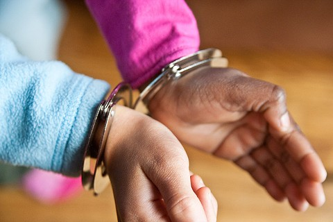 Handcuffing kids for pot is not a valid public health approach, critics say. - VIA FLICKR STEVEN DEPOLO