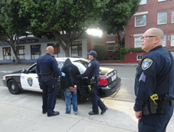 Oakland cops take a suspect into custody. - DARWIN BONDGRAHAM