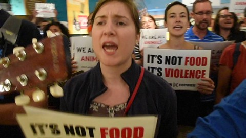The animal rights group Direct Action Everywhere staging a protest in the Berkeley Whole Foods Market (via Youtube).