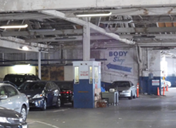 Inside the parking garage, part of the same building currently housing the Amethod middle and high schools.