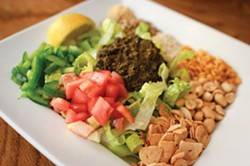 Burma Superstar's tea leaf salad — one of the Burmese dishes the restaurant chain helped popularize. - CHRIS DUFFEY/FILE