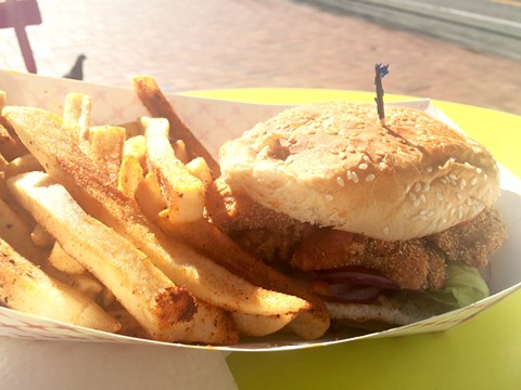 The fish sandwich comes with a side of seasoned fries. - LUKE TSAI