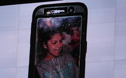 An image of Elena Mondragon was projected from a cell phone during the council meeting.