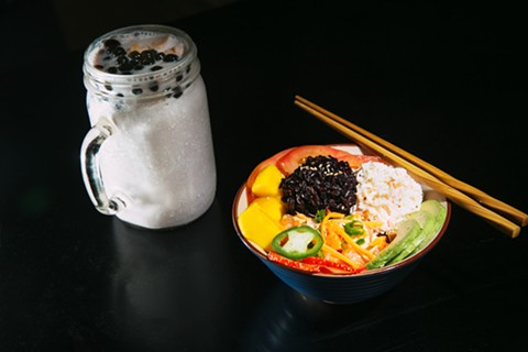 Milk tea and poke at T&Bowl. - ANDRIA LO