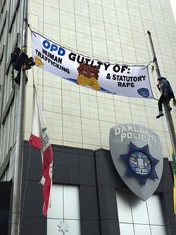 Protesters at the Oakland Police Department's headquarters on Friday, June 17. - ALI WINSTON