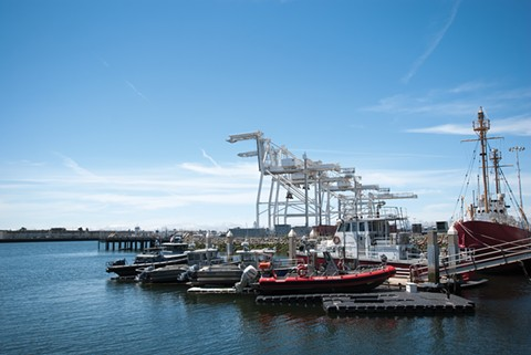 The cranes at Howard Terminal, as seen from Jack London Square, would make for a postcard-worthy ballpark site. But some worry about access to the location, which is part of the Port of Oakland. - PHOTO BY SCOTT MORRIS