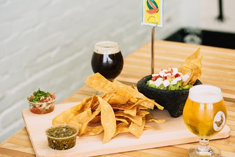 Chips and guac, and brew, arrive in the Laurel. - ANDRIA LO