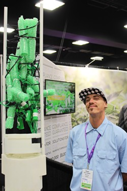 Evan Andrea stands next to the model of Bella Toka Grow Box he used to demo at the summit. - NATE SHEIDLOWER
