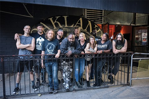 Oakland Metro Operahouse owner Tom Dean (back row, second from right) and staff out front of the venue. - GEORGE BAKER