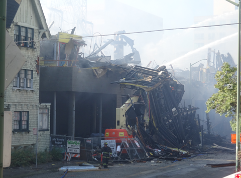 The entire multi-story frame collapsed and burned. - DARWIN BONDGRAHAM