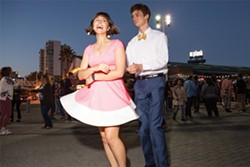 A young couple gives it a spin during Friday night's Dancing Under the Stars at Jack London Square (page 62). - PHOTO BY SAM ZIDE