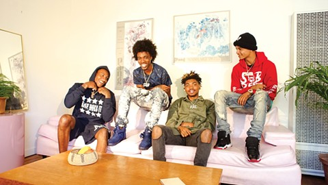 Left to right: Slimmy B, Da Boii, Yhung TO, and Lul G chilling at an apartment in the East Bay. - PHOTO BY JEFFREY CHERY