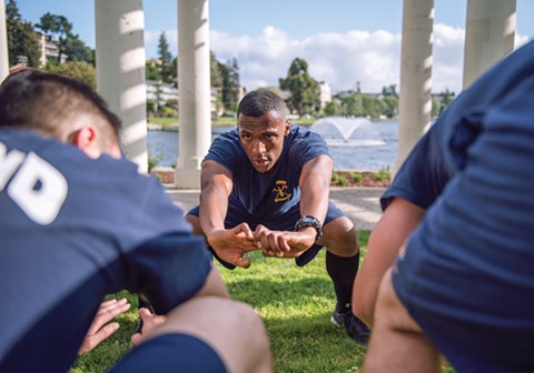Mason and his classmates sweat on the infamous Chief's Run. Led by battalion chief James Bowron, new recruits are put through a brutal workout around Oakland's Lake Merritt at the end of a long day. - ROSA FURNEAUX