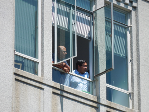 Berkeley Mayor Jesse Arreguin looks down on the demonstration from the 5th floor mayor's offices. - DARWIN BONDGRAHAM