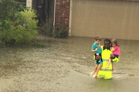 A Harris County sheriff's deputy rescues children during historic flooding in Houston. - HARRIS COUNTY SHERIFF'S OFFICE