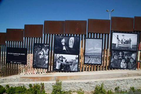 Photographs of farm workers on the border wall - PHOTO COURTESY OF DAVID BACON