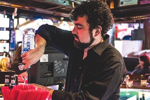 Of course, a bar would be nothing without bartenders like Ricky's Andrew Nelson. - PHOTO BY DARRYL BARNES