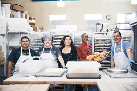 Denis Gomez, Megan Ledet, Delia Desmond, Mahasin Munir, and Luis Andrade live the co-op lifestyle at Arizmendi on Lakeshore. - PHOTO BY KALA MINKO