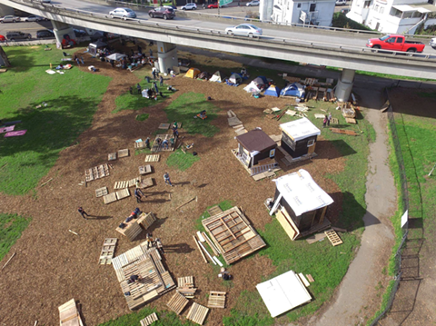 The Village, an unsanctioned homeless camp, was established by volunteers but evicted by the city in February. - THE VILLAGE