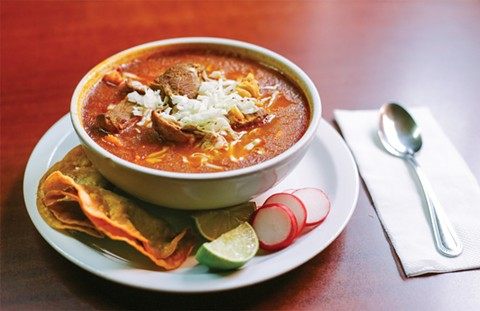 The pozole is rich and meaty — no extras required. - PHOTO BY MELATI CITRAWIREJA