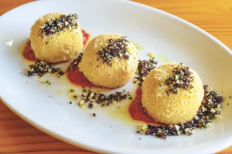 The fried gnudi, or ricotta dumplings, come three to an order.
