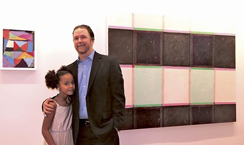 Kevin Moore and his daughter at the grand opening of The Space.