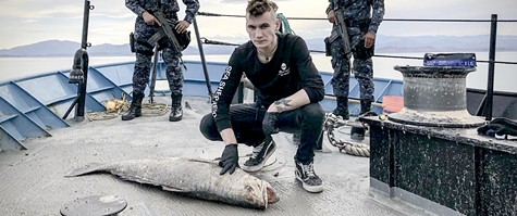Activist Jack Hutton with a dead totoaba, aboard the Sea Shepherd.