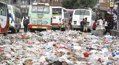 Garbage litters the streets of Kathmandu after a recent flood there.