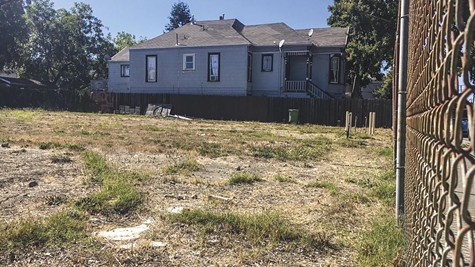 Parcels such as this empty lot in West Oakland could be taxed up to $6,000 per year.