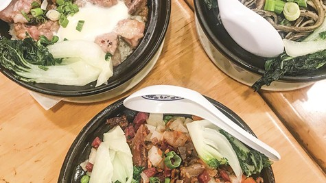 An array of clay pot dishes await at Best Taste Restaurant.